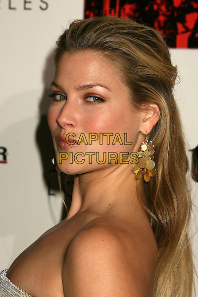 ALI LARTER.The 2006 Art of Elysium Annual Art,  Benefit at Minotti, Los Angeles, California, USA,.02 December 2006..portrait headshot gold earrings looking over shoulder.CAP/ADM/BP.©Byron Purvis/AdMedia/Capital Pictures.