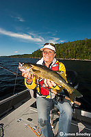 Female angler with walleye