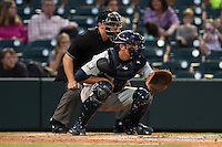 Home plate umpire Jordan Albarado and Brevard County Manatees  catcher Parker Berberet (8) during a game against the Lakeland Flying Tigers on April 10, 2014 at Joker Marchant Stadium in Lakeland, Florida.  Lakeland defeated Brevard County 6-5.  (Mike Janes/Four Seam Images)