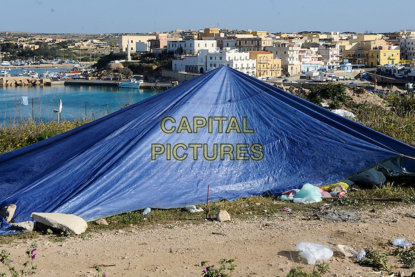 ATMOSPHERE .Immigrants in the area of the old port of Lampedusa..22nd March 2011.blue tent  makeshift gv general view g.v. .CAP/EPS/GG.©Giuseppe Giglia/EPS/Capital Pictures.