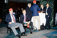 People gather in a back area of the ballroom in the Midtown Hilton at the election night victory rally for Republican presidential nominee Donald Trump, on Tues., Nov. 8, 2016. Trump was named president-elect in the early hours of Nov. 9, 2016.