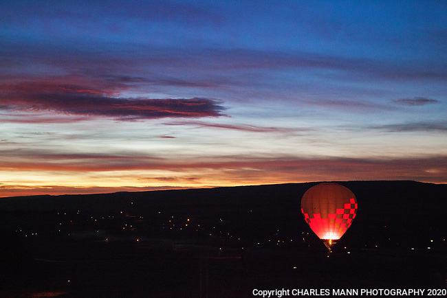 The Red Rock BalloonRally is held on the first weekend of each December at Red Rock State Park near Gallup, New Mexico. The day begins with a Dawn Patrol where a few balloons go aloft just before dawn to determine the strength and direction of the winds.