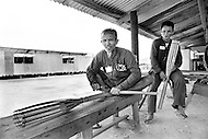 Bien Hoa, Vietnam. April 1970. Two Vietnamese prisoners of war make artificial limbs at a prison camp in Bien Hoa, Vietnam. During the Vietnam War, businessman Ross Perot travelled to Southeast Asia to determine how to improve the treatment of American prisoners being held in Vietnam.