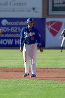 Yensys Capellan (10) of the Ogden Raptors takes his lead off of second base against the Grand Junction Rockies on June 19, 2014 at Lindquist Field in Ogden, Utah. (Stephen Smith/Four Seam Images)