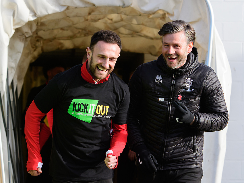Lincoln City's Neal Eardley, left, and Lincoln City's assistant manager Nicky Cowley during the pre-match warm-up<br /> <br /> Photographer Chris Vaughan/CameraSport<br /> <br /> The EFL Sky Bet League Two - Lincoln City v Northampton Town - Saturday 9th February 2019 - Sincil Bank - Lincoln<br /> <br /> World Copyright © 2019 CameraSport. All rights reserved. 43 Linden Ave. Countesthorpe. Leicester. England. LE8 5PG - Tel: +44 (0) 116 277 4147 - admin@camerasport.com - www.camerasport.com