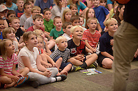 NWA Democrat-Gazette/BEN GOFF @NWABENGOFF<br /> Children watch as Ellen Winters and Galen Harp of Institute of Jugglology from Fayetteville perform on Thursday June 9, 2016 at the Bentonville Public Library. Harp and Winters won the International Jugglers Association team juggling world championship in 2014 with their act.