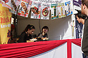 Two ladies serve food on a stall at the 10th Japanese Matsuri Festival, Trafalgar Square, London.