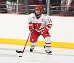 MADISON, WI - SEPTEMBER 29: Bobbi-Jo Slusar #10 of the Wisconsin Badgers women's hockey handles the puck against the Quinnipiac Bobcats at the Kohl Center on September 29, 2006 in Madison, Wisconsin. The Badgers beat the Bobcats 3-0. (Photo by David Stluka)