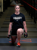 Assistant UVa strength and conditioning coach   Jenny Shultis demonstrates the front to back lunge exercise at the McCue Center weight room on campus at the University of Virginia in Charlottesville, VA. Photo/Andrew Shurtleff