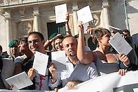 I deputati scendono dal tetto e mostrano la costituzione<br /> Roma 07-09-2013 Piazza Montecitorio. 12 deputati del Movimento 5 Stelle hanno occupato il tetto di Palazzo Montecitorio per protestare contro quello che secondo loro e' un tentativo di stravolgere la costituzione con il DDL sulle riforme. Espongono uno striscione con scritto: la costituzione e' di tutti.<br /> 12 Deputates of Mvement 5 Stars climbed the Lower Chamber's roof to protest against , they says, the attempt of the Parliament to change the constitution with the reforms.<br /> Photo Samantha Zucchi Insidefoto