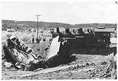 #483 on side and jack-knifed with tender.  #494 off track but standing upright adjacent to jack-knifed train.<br /> D&amp;RGW  Bocea Hill in Durango area, CO  9/27/1958