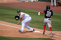 Lynchburg Hillcats first baseman Anthony Miller (40) stretches for a throw as Blake Perkins (22) runs through the bag during the first game of a doubleheader against the Potomac Nationals on June 9, 2018 at Calvin Falwell Field in Lynchburg, Virginia.  Lynchburg defeated Potomac 5-3.  (Mike Janes/Four Seam Images)