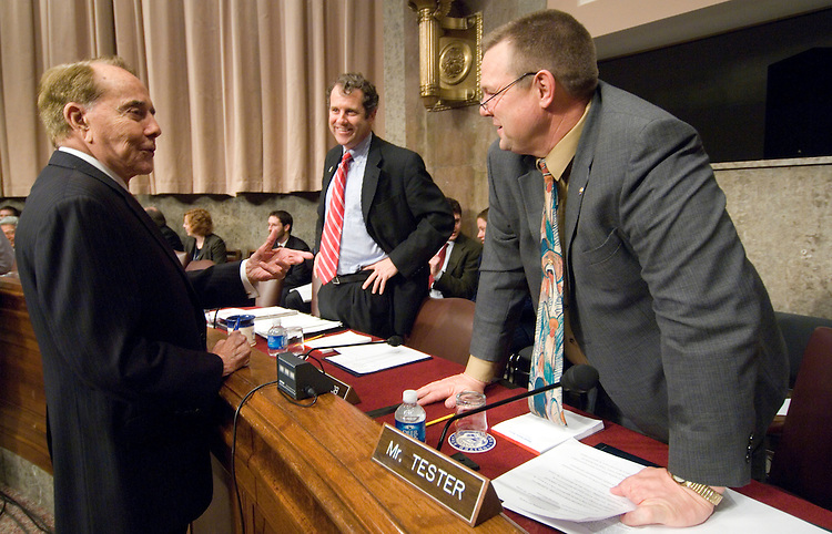 From left, former Sen. Bob Dole, R-Kan., speaks with Sen. Sherrod Brown, D-Ohio, and Sen. John Tester, D-Mont.,before the start of the Senate Veterans Affairs Committee confirmation hearing for James Peake, nominee to be secretary of Veterans Affairs, on Wednesday, Dec. 5, 2007.