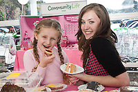 ASDA's Forest Town superstore ran a fun event in aid of its 'Tickled Pink' campaign. Pictured trying out the cakes is Kayleigh Jewkes, 5 of Forest Town with ASDA's Charlie Horobin