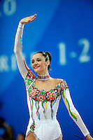 Anna Bessonova of Ukraine waves to fans after performing with ribbon at 2009 Pesaro World Cup on May 1, 2009 at Pesaro, Italy.  Photo by Tom Theobald.