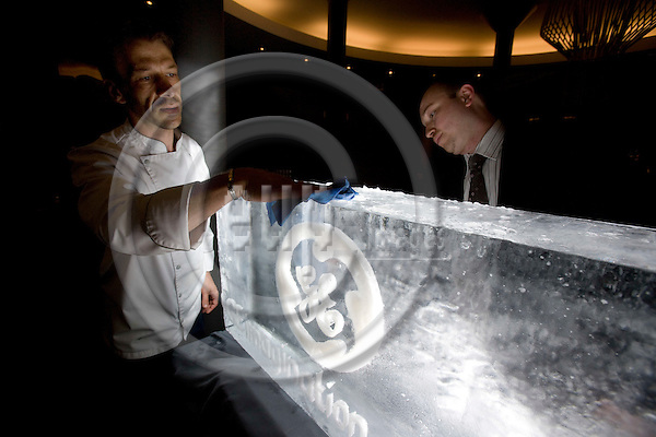 BRUSSELS - BELGIUM - 28 MAY 2008 -- Hotel staff polish a big ice cube symbolizing GEs aggressive water reduction target to free up fresh water supplies. The company pledges to reduce fresh water use by 20% by 2012.  Photo: Erik Luntang/EUP-IMAGES