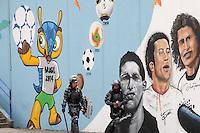 RIO DE JANEIRO, RJ ,22 DE MARCO DE 2013 - O BATALHÃO DE CHOQUE INVADIU A ALDEIA MARACANÃ - Policiais do batalhão de choque invadiu a Aldeia Maracanã nesta tarde e houve tumulto do lado de fora da Aldeia. A Avenida Maracanã chegou a ser interditada por uma hora e manifestantes entraram em confronto com a policia que disparou tiros de balas de borracha, e usou esplay de pimenta. Uma ativista do FEMEN conhecida como Sara tirou a blusa em protesto e foi detida pela policia. FOTO: SANDRO VOX/BRAZIL PHOTO PRESS