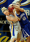 BROOKINGS, SD - MARCH 23:  Mariah Clarin #40 from South Dakota State ties up the ball with Alexis Akin-Otiko #45 from Creighton in the second half of their WNIT game Sunday afternoon at Frost Arena in Brookings. (Photo by Dave Eggen/Inertia)