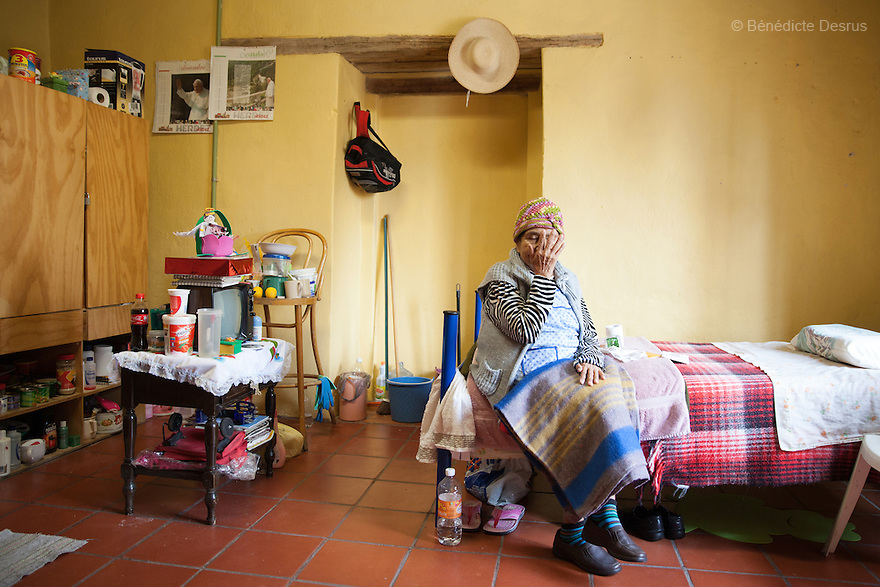 Normita, a resident of Casa Xochiquetzal, in her bedroom at the shelter in Mexico City, Mexico on January 6, 2015. Casa Xochiquetzal is a shelter for elderly sex workers in Mexico City. It gives the women refuge, food, health services and a space to learn about their human rights, as well as courses to help them rediscover their self-confidence and deal with traumatic aspects of their lives. Casa Xochiquetzal provides a space to age with dignity for a group of vulnerable women who are often invisible to society at large. It is the only such shelter existing in Latin America. Photo by Bénédicte Desrus