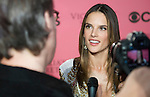 Victoria's Secret Angel Alessandra Ambrosio speaks to the press before Tuesday's screening party for the 2011 Victoria's Secret Fashion Show.
