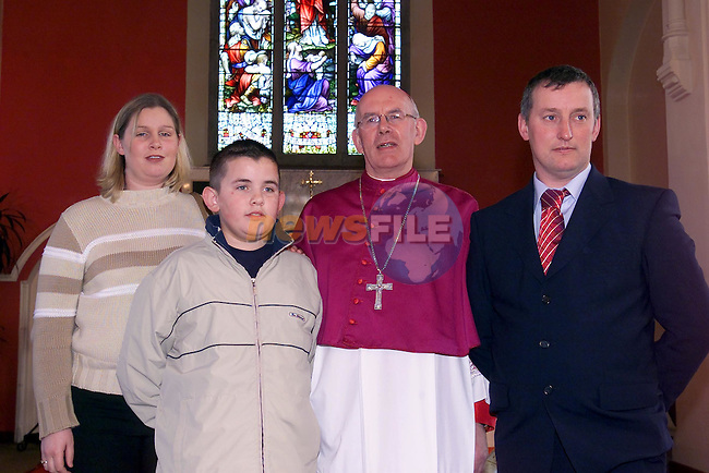 Matthew Kirwan with his dad John adn Sister Charline and Bishop Brady..Picture Fran Caffrey Newsfile.