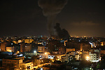 "A picture taken on November 12, 2018, shows a ball of fire and smoke rise above the building housing the television station al-Aqsa TV during an Israeli air strike in Gaza City. Israel's military said it was carrying out air strikes ""throughout the Gaza Strip"" after a barrage of rocket fire from the Palestinian Gaza Strip towards Israel. The flare-up follows a clash that erupted during an Israeli special forces operation in the Gaza Strip the previous night that killed eight people of Hamas movement. Photo by Ashraf Amra"