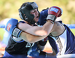 Nevada's Jarred Santos lands a body shot against Air Force's Jacob Berggren in an intercollegiate boxing match at TJ's Corral at Carson Valley Inn, in Minden, Nev., on Saturday, Sept. 13, 2014. Santos won the bout.<br /> Photo by Cathleen Allison