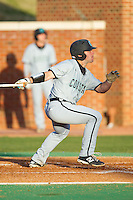 Richard Carter (10) of the Coastal Carolina Chanticleers follows through on his swing against the High Point Panthers at Willard Stadium on March 14, 2014 in High Point, North Carolina.  The Panthers defeated the Chanticleers 3-0.  (Brian Westerholt/Four Seam Images)