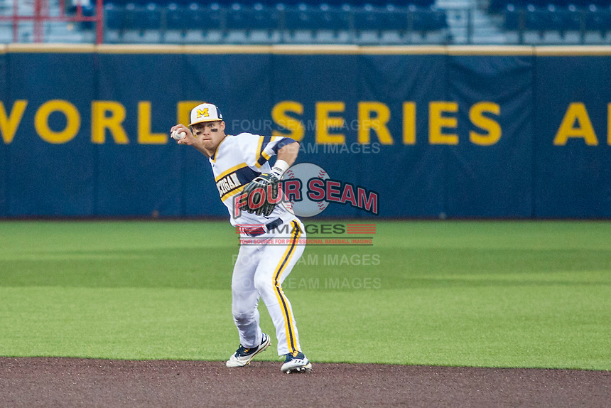 Michigan Wolverines second baseman Jake Bivens (18) makes a throw to first base against the Eastern Michigan Hurons on May 3, 2016 at Ray Fisher Stadium in Ann Arbor, Michigan. Michigan defeated Eastern Michigan 12-4. (Andrew Woolley/Four Seam Images)