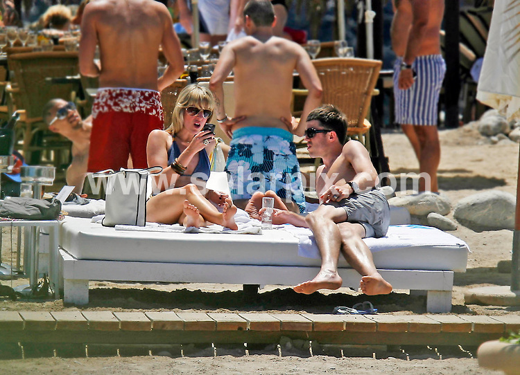 **EXCLUSIVE PICTURES FROM SOLARPIX.COM**.**WORLDWIDE SYNDICATION RIGHTS EXCLUDING SPAIN & PORTUGAL****NO SPAIN & PORTUGAL**.Manchester Utd and England football ace, Michael Carrick and his wife Lisa looked bored while on holiday in Spain this week. The couple lounged on a beach bed while Lisa spent the day texting friends on her mobile phone and Michael sat there yawning. They took a brief stroll down to the jetty before heading back to their bed for more of the same..JOB REF:  9219    MAD       DATE:  14_06_2009.**MUST CREDIT SOLARPIX.COM OR DOUBLE FEE WILL BE CHARGED**.**NO ONLINE USAGE BEFORE FEE AGREED**.**CALL SOLARPIX : +34 952 811 768 or LOW RATE FROM UK 0844 617 7637**