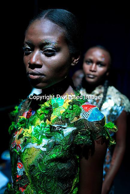 JOHANNESBURG, SOUTH AFRICA MARCH 20: A model walking for the South African designer Marianne Fassler before a show at Mercedes Benz Africa fashion autumn/ winter 2014 week on March 20, 2014 held in Johannesburg, South Africa. South African designers showed their best fall/winter collections. (Photo by: Per-Anders Pettersson)