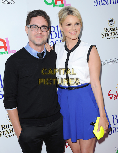 Kevin Manno &amp; Alexandra &quot;Ali&quot; Elaine Fedotowsky<br /> 'Blue Jasmine'  L.A. premiere at The Academy of Motion Pictures Arts and Sciences in Beverly Hills, California, USA.<br /> 24th July 2013 <br /> half length top skirt purple black white sleeveless black top glasses yellow clutch bag couple <br /> CAP/DVS<br /> &copy;DVS/Capital Pictures