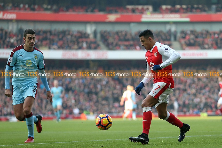 Alexis Sanchez of Arsenal ad Matthew Lowton of Burnley during Arsenal vs Burnley, Premier League Football at the Emirates Stadium on 22nd January 2017