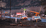 Crews work to restore power after Thursday's brush fire that destroyed 29 homes and killed one woman in Pleasant Valley, south of Reno, Nev., on Friday, Jan. 20, 2012. .Photo by Cathleen Allison