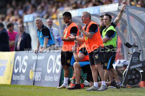 London Wasps defence coach Brad Davis shouts out encouragement during a break in play. European Champions Cup play-off, between London Wasps and Stade Francais on May 18, 2014 at Adams Park in High Wycombe, England. Photo by: Patrick Khachfe / JMP