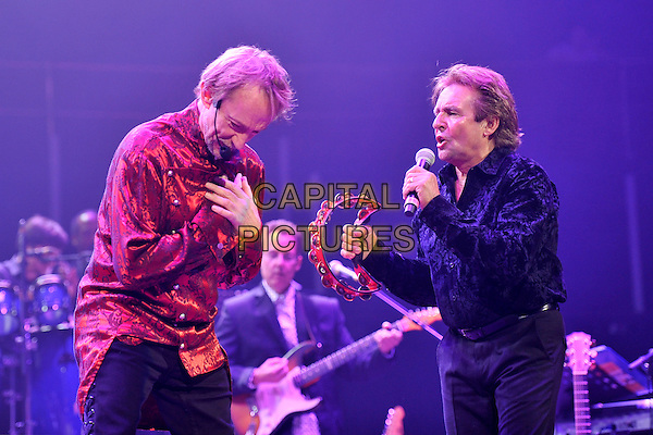 THE MONKEES - Davy Jones (R) .performs on stage at Royal Albert Hall,  London, England, UK, May 19th 2011..music concert live gig half length  black   microphone singing  shirt  tambourine  red .CAP/MAR.© Martin Harris/Capital Pictures.