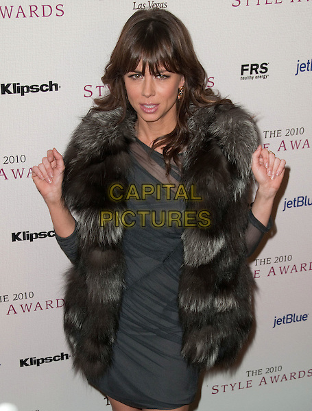 NATASHA LEGGERO.2010 Hollywood Style Awards held at The Billy Wilder Theater at the Hammer Museum, Los Angeles, California, USA..December 12th, 2010.half length black brown blue fur jacket coat dress sheer hands.CAP/ADM/JS.©Jay Steine/AdMedia/Capital Pictures.