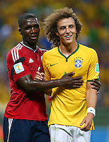 Cristian Zapata of Colombia and David Luiz of Brazil embrace