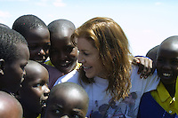 In the heart of Kenya's famous Maasai Mara, otherwise known as the Seventh Wonder of the World, Michelle Stark, founder of Matanya's Hope shares heartfelt greetings with students at Loigero Primary Day School. Children who attend this school face the hardships of extreme poverty often walking up to ten kilometers in their bare feet just to attend school. Many of the children will be forced to end their education by 8th grade due to a lack of money.  Sponsorship through non-profits such as Matanya's Hope helps to provide academic scholarships for motivated students who desire to continue their education but lack the means to do so.