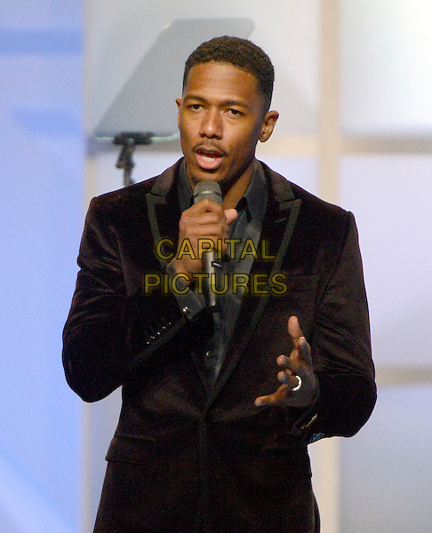 "19 January 2013 - Washington D.C, District of Columbia - Nick Cannon. ""Kids' Inaugural: Our Children. Our Future at the Washington Convention Center. .half length black suit microphone .CAP/ADM/CNP/RS.©Ron Sachs/CNP/AdMedia/Capital Pictures."