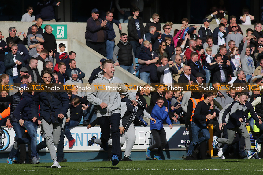Millwall fans run onto the pitch at the final whistle to celebrate their victory which secures their place in the Play Off's  during Millwall vs Oldham Athletic, Sky Bet League 1 Football at The Den on 30th April 2016