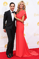LOS ANGELES, CA, USA - AUGUST 25: Model Heidi Klum and designer Zac Posen arrive at the 66th Annual Primetime Emmy Awards held at Nokia Theatre L.A. Live on August 25, 2014 in Los Angeles, California, United States. (Photo by Celebrity Monitor)