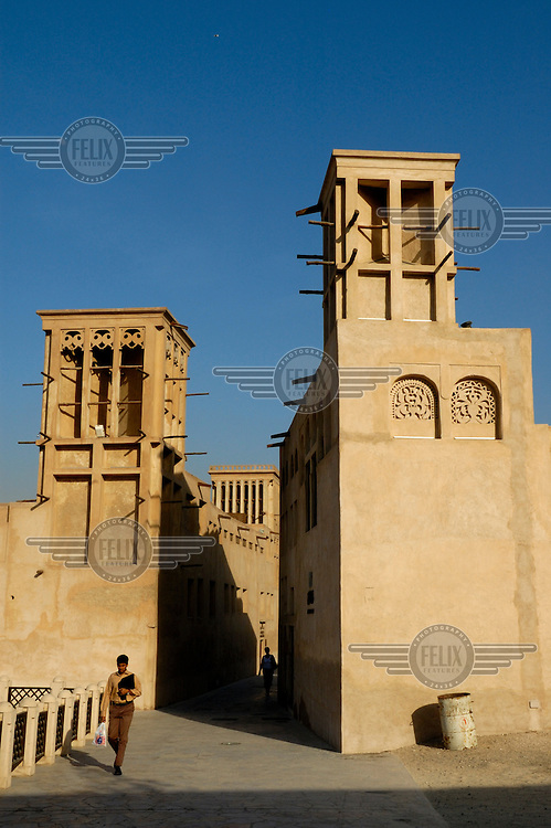 Wind towers of the restored Bastakia quarter, which is a rare example of historical preservation in Bur Dubai.  They were originally designed as a traditional household cooling system, providing relief from the the desert sun and high humidity..