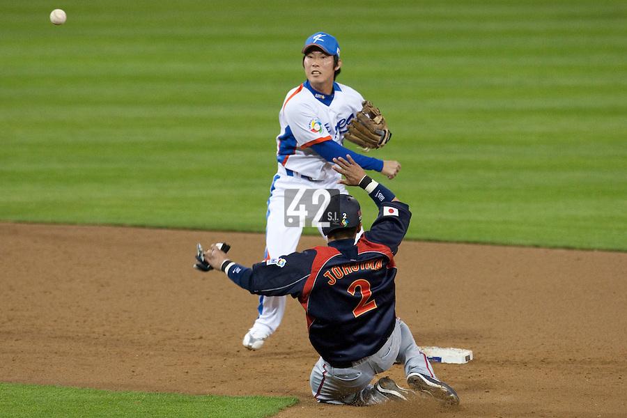 17 March 2009: #16 Ki Hyuk Park of Korea turns the double play against #2 Kenji Johjima of Japan during the 2009 World Baseball Classic Pool 1 game 4 at Petco Park in San Diego, California, USA. Korea wins 4-1 over Japan.