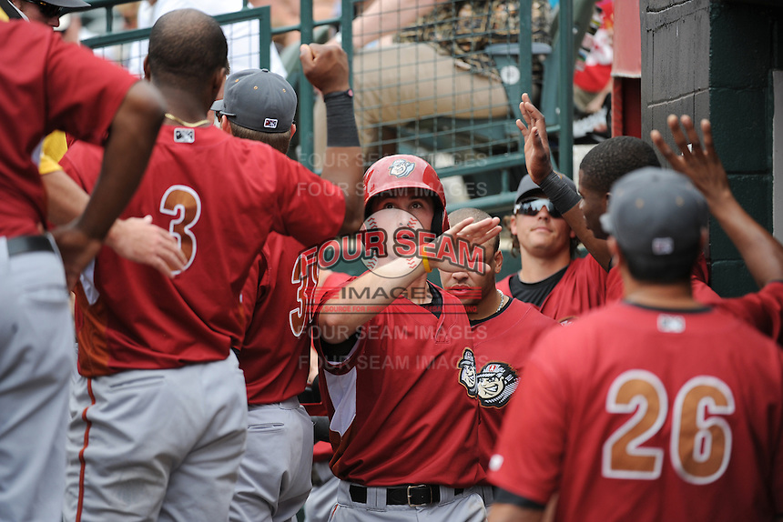 Altoona Curve infielder Jarek Cunningham (24) celebrates with team mates after hitting a home run during game against the Trenton Thunder at ARM & HAMMER Park on July 24, 2013 in Trenton, NJ.  Altoona defeated Trenton 4-2.  Tomasso DeRosa/Four Seam Images