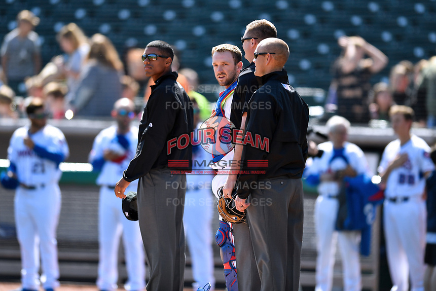 First base umpire Edwin Moscoso, Tennessee Smokies catcher Ian Rice (5), home plate umpire Ryan Wilhelms, and third base umpire Brock Ballou before a game between the Jackson Generals and the Tennessee Smokies at Smokies Stadium on April 11, 2018 in Kodak, Tennessee. The Generals defeated the Smokies 6-4. (Tony Farlow/Four Seam Images)