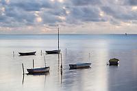 A tranquil photo of small boats at Kaneohe Bay on Windward O'ahu.