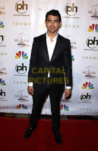 Joe Jonas.2012 Miss USA Pageant red carpet arrivals at Planet Hollywood Resort and Casino, Las Vegas, Nevada, USA..3rd June 2012.full length black suit white shirt .CAP/ADM/MJT.© MJT/AdMedia/Capital Pictures.