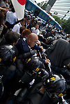 August 15, 2011, Tokyo, Japan - Shinichi Kamijo, (Centre) the leader of Gishin Gokoku-kai and other right-wingers scuffle with Police as right-wingers try to get to left-wing demonstrators holding a demonstration against Yasukuni shrine. (Photo by Bruce Meyer-Kenny/AFLO) [3692]
