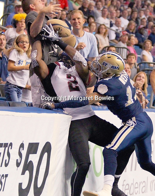 05 June 2010: Oklahoma City wide receiver Xavier Lee cannot hold onto the pass as Tampa Bay defensive back Brandon Hefflin forces him into the crowd. The Tampa Bay Storm defeated the Oklahoma City Yard Dawgz 50-48 at the St. Pete Forum in Tampa, Florida